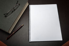 Notepad on a desk Royalty Free Stock Photo