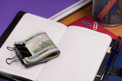 Notepad with dollar banknotes Stock Photo