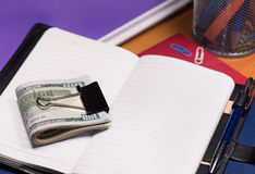 Notepad with dollar banknotes Royalty Free Stock Photos
