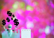 Notepad with dollar and robot  on wood board background.using wallpaper or for education, business photo.Take note of the p Royalty Free Stock Photography
