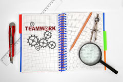 Notepad with drawing teamwork Royalty Free Stock Photography