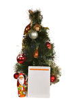 Notepad and dressed Christmas tree Royalty Free Stock Photography