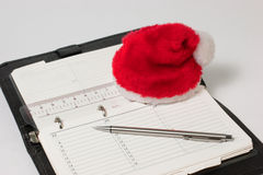 Notepad end hat of Santa Claus Stock Image