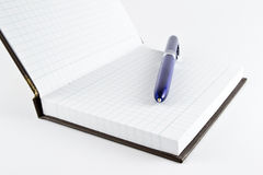 Notepad, the first page and ballpoint pen. In studio environment Royalty Free Stock Image