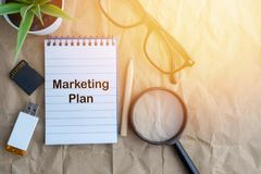 MARKETING PLAN on wooden paper background. Business and education concept royalty free stock photography