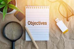 Words OBJECTIVES on wooden paper background. Business and education concept stock images