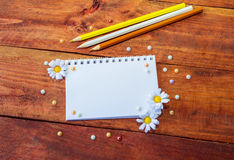 Notepad, flowers and pencils Stock Photography