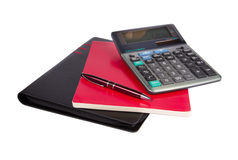 Notepad, folder, pen and calculator. Isolated on white background Stock Images