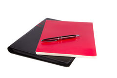 Notepad, folder and pen. Isolated on white background Stock Photography