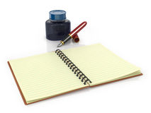Notepad with fountain pen and ink jar Stock Images