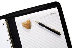 Notepad and gingerbread heart Stock Photos