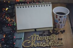 Notepad, glass and the inscription Marry Christmas Stock Photo