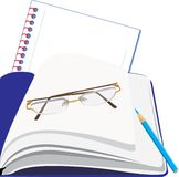 Notepad and glasses Royalty Free Stock Photos