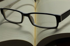 Notepad and glasses Royalty Free Stock Photo