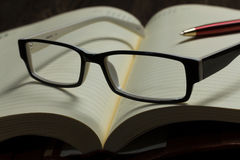 Notepad and glasses Royalty Free Stock Photography