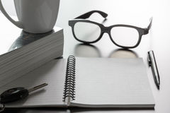 Notepad glasses and pen Stock Photography