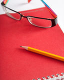 Notepad, glasses and a pencil Royalty Free Stock Images