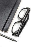 Notepad, glasses and pencil Royalty Free Stock Images
