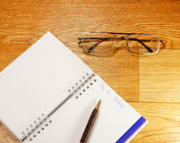 Notepad and glasses Royalty Free Stock Image