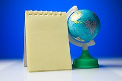 Notepad with globe Royalty Free Stock Photography