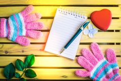Notepad with glove on wood board background.using wallpaper for education, business photo.Take note of the product for book with p. Aper and concept, object or royalty free stock photo