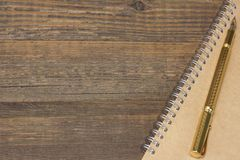 Notepad With Gold Fountain Pen On The Old Wood Table Royalty Free Stock Photo