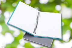 Notepad on Green bokeh Stock Images