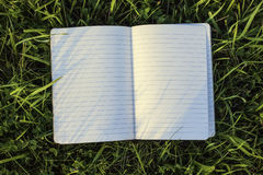 Notepad. On the green grass Royalty Free Stock Photo