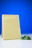 Notepad with green leaves Royalty Free Stock Images