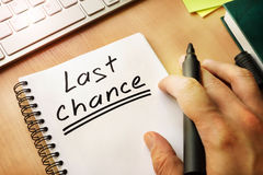 Last chance. Notepad with handwriting title Last chance stock photography