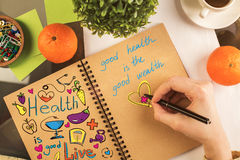 Notepad with health sketch Stock Images