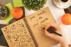 Notepad with health sketch Royalty Free Stock Image