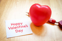 Notepad with heart toy and red pen on wooden table Happy Valenti Royalty Free Stock Photos