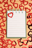 Notepad and hearts Stock Images