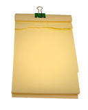 Notepad isolated on a white background. Yellow note pad isolated on a white background, office supplies. Blank so you can insert your own message Royalty Free Stock Images