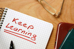 Notepad with keep learning. Stock Photo