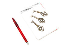 Notepad with keys Royalty Free Stock Image