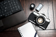 Notepad, laptop and photography equipment Royalty Free Stock Photos