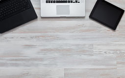 Notepad and laptop on wood table. View from above Stock Images