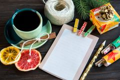 Notepad lays on the wooden background to make a list to do things or list of presents for friends and family. New year stock photography