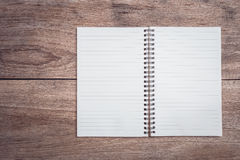 Notepad / lined paper on wooden table top view Stock Photo