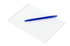 The notepad and lying on a blue pen isolated on white Stock Photos