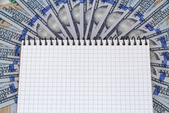 Notepad lying on dollars Royalty Free Stock Photo