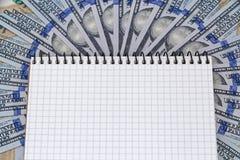 Notepad lying on dollars Royalty Free Stock Photo
