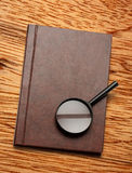 Notepad and magnifying glass Stock Photo