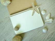 Notepad with marine objects. Royalty Free Stock Photos