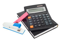 Notepad, marker, stapler and calculator Stock Photography