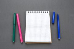 Notepad and markers royalty free stock images