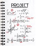 Notepad with a mathematical project with red marks Royalty Free Stock Image