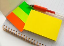Notepad,memo and pen. On white background Royalty Free Stock Photography